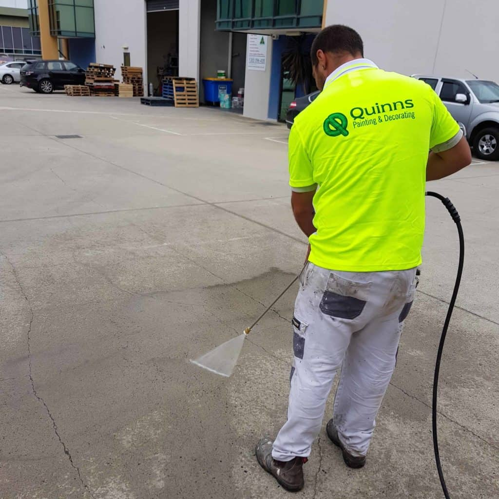 pressure washing the ground outside an industrial area