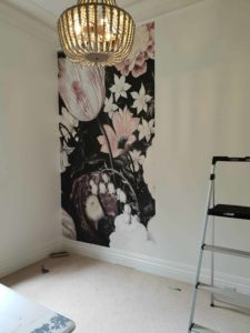 Pink and white floral wallpaper with black background wallpaper installation in progress