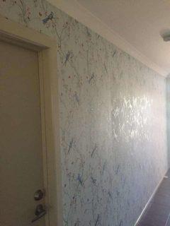 Wallpaper of birds in hallway