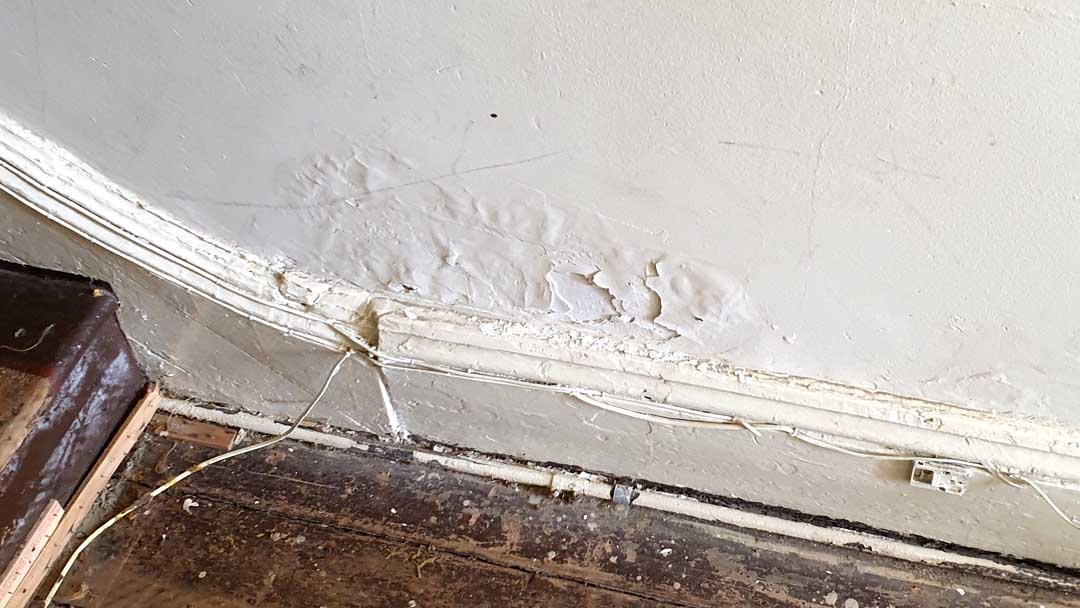 bubbled paint on plaster wall