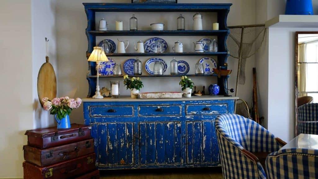 bright blue kitchen hutch with ornaments