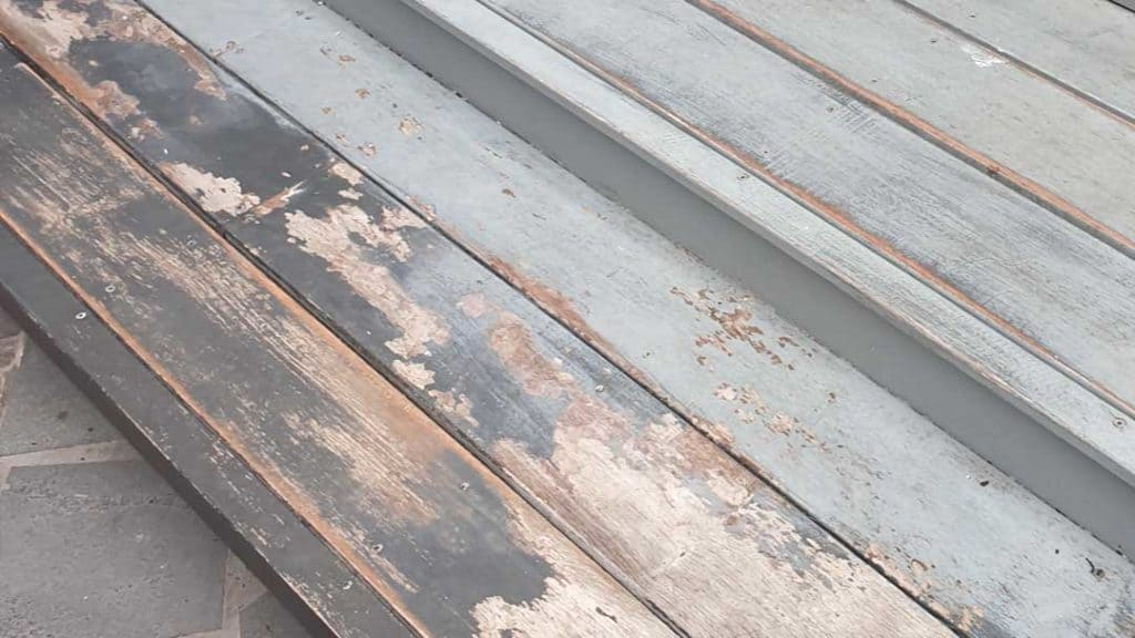 timber deck with peeling paint