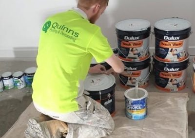 Guy mixing dulux paint pic2