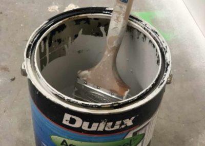 Paint brush sitting in Dulux aquanamel paint can
