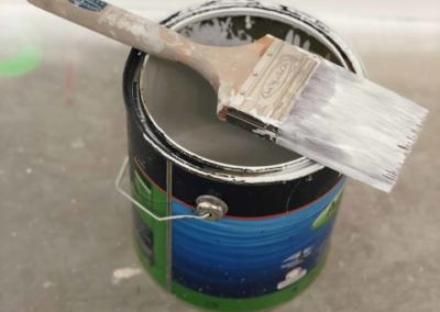 Paint brush sitting on Dulux paint can