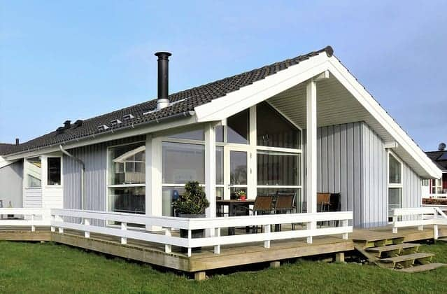 lovely white and black single story home with deck and big windows