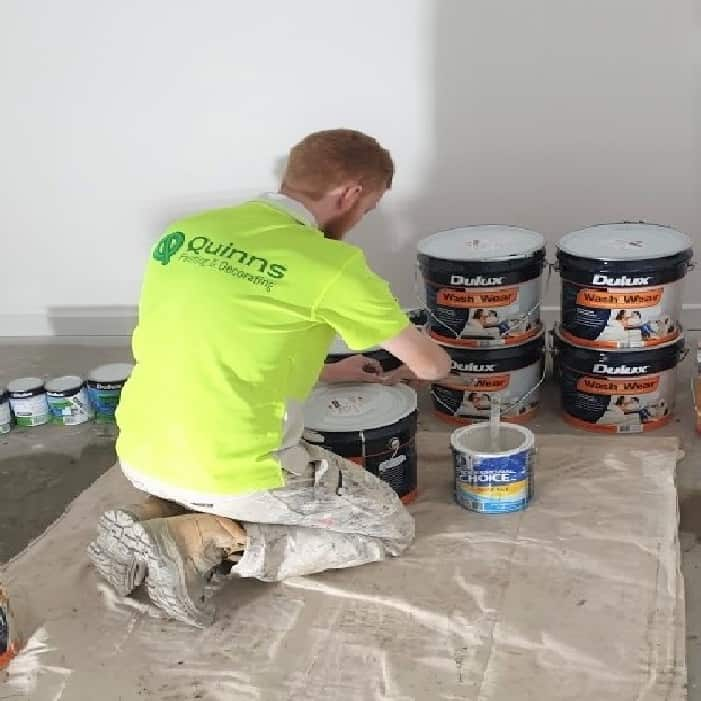 Guy mixing dulux paint