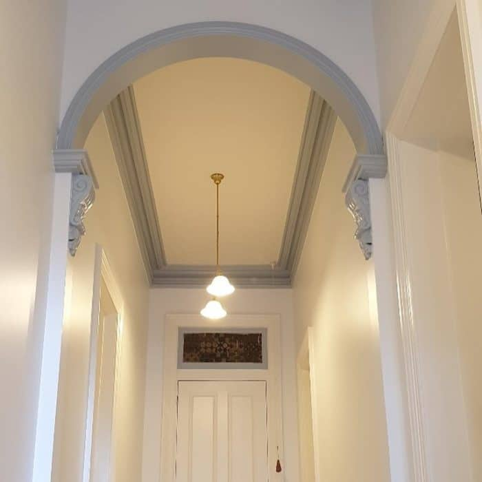 painting the arched walk ways in an old victorian house