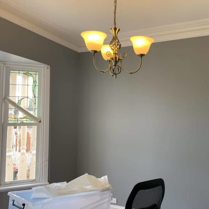 painting the walls of a house grey