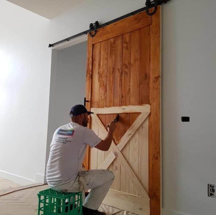 painting wooden door inside a home