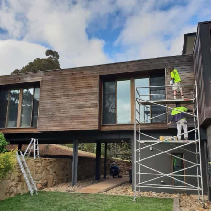 staining of house exterior wood on a modern home