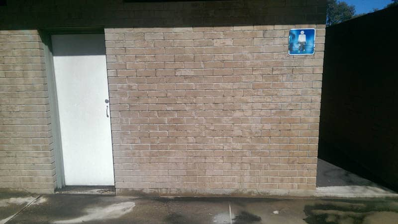 Toilet block wall after being sandblasted