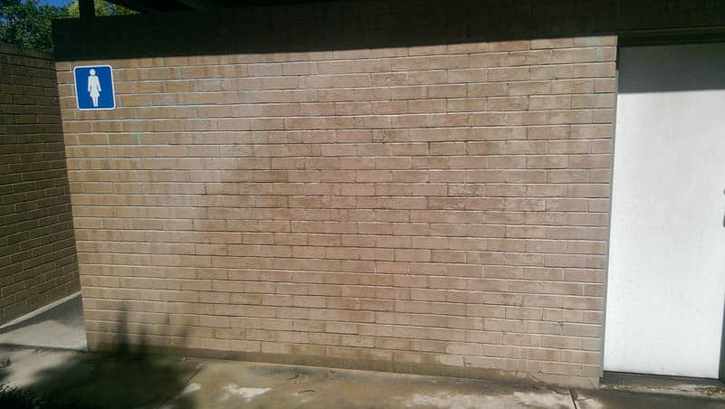 Womens toilet block wall after being sandblasted